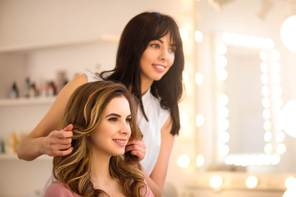 Attracting Salon Customers, Woman Getting Her Hair Done By Stylist