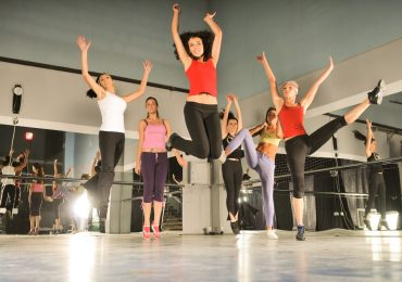 dance studio marketing ideas, group of girls jumping in air