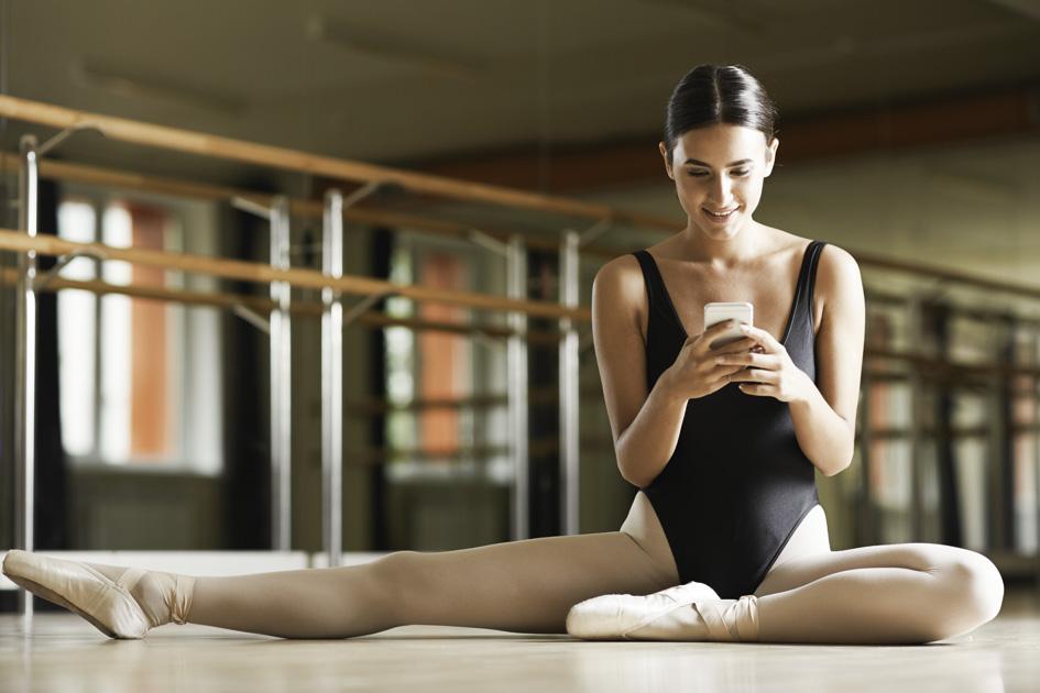 apps for dance studios, Ballerina on her phone