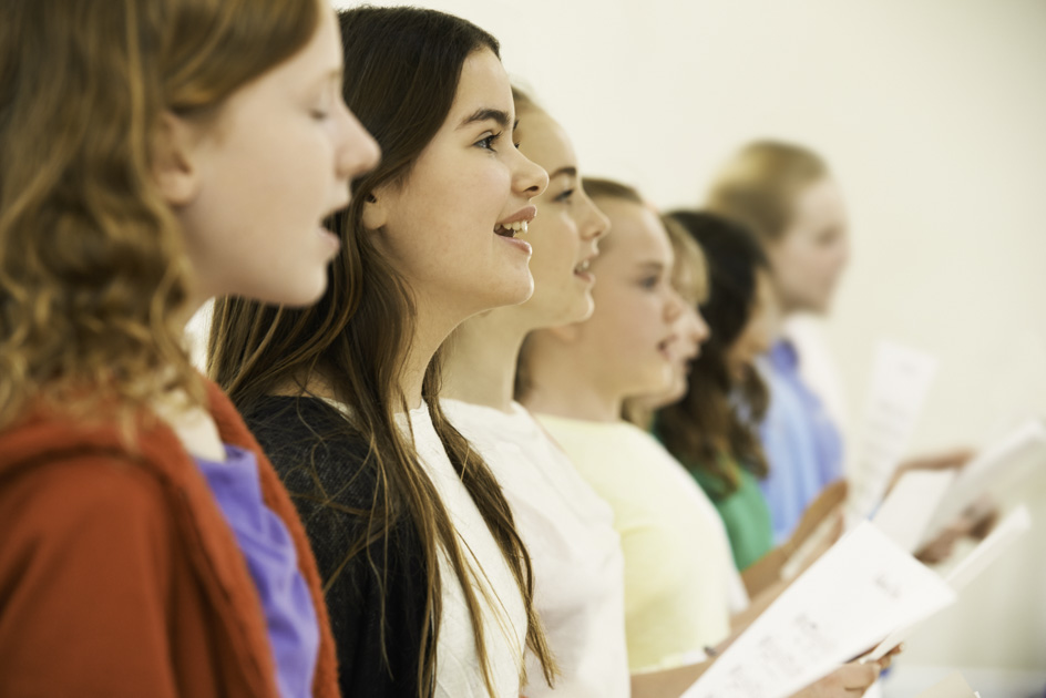 customer retention, Group Of School Children Singing