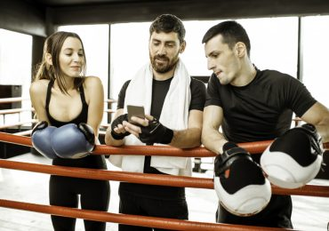 martial arts social media marketing, three boxers on phone