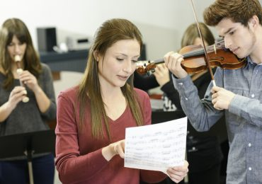misconceptions about learning music, instructor teaching adult music student