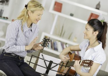 music classes for adults, guitar instructor with adult student