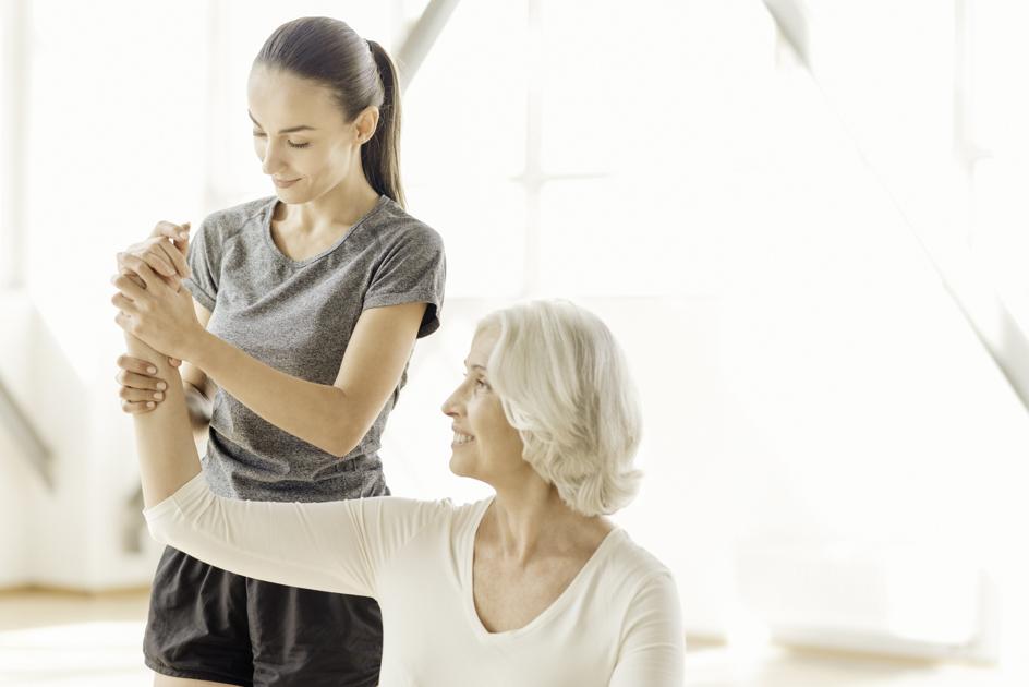 wellness center marketing, wellness coach with client