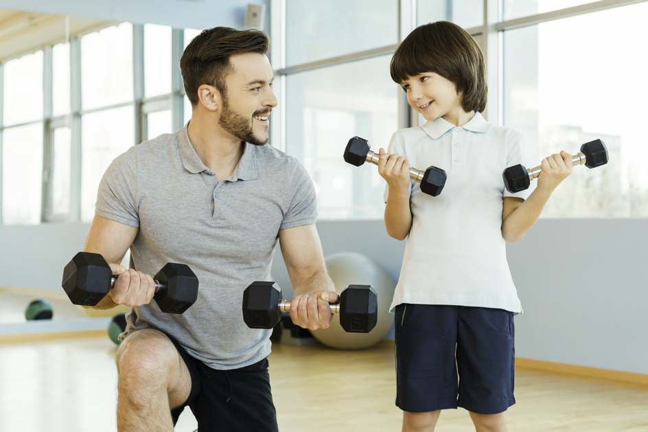 gym for children, young boy and personal trainer