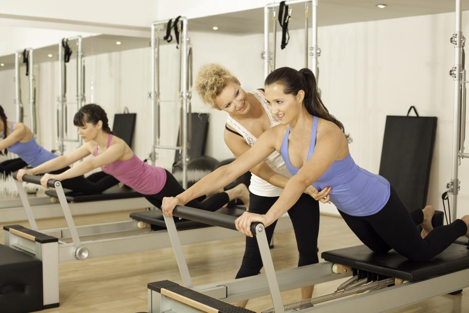 Pilates hire staff, Pilates instructor teaching a class