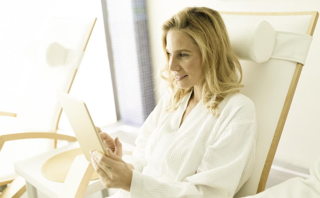 wellness center social media, woman checking phone