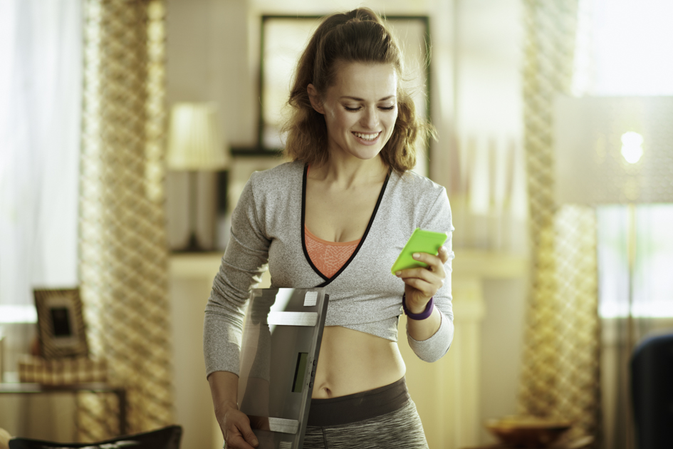 Social media personal trainer, personal trainer on her phone