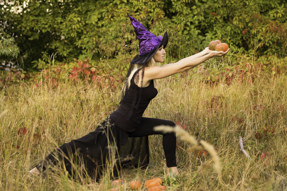 Halloween yoga marketing, woman practicing yoga in Halloween costume