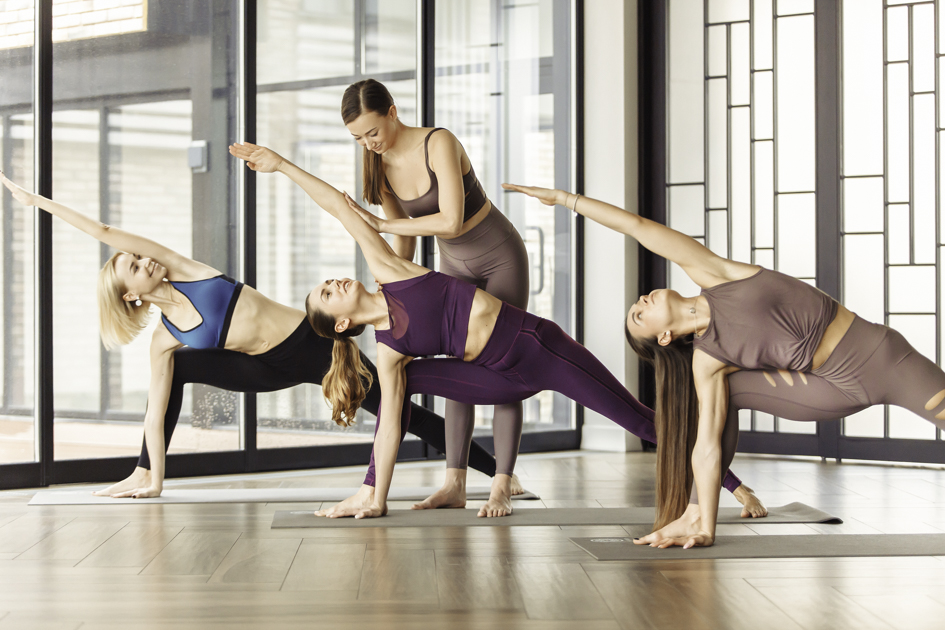yoga studio schedule, yoga instructor with class