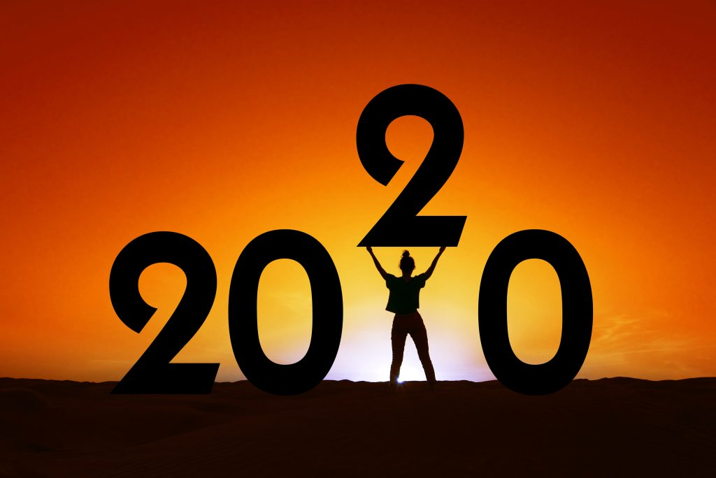 new year marketing strategy, 2020, silhouette of a woman standing in the sunset,