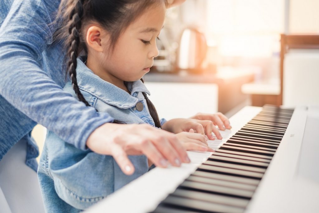 music school management system, girl playing piano