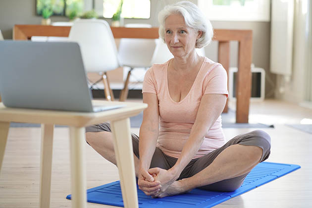 online services, senior woman doing fitness at home