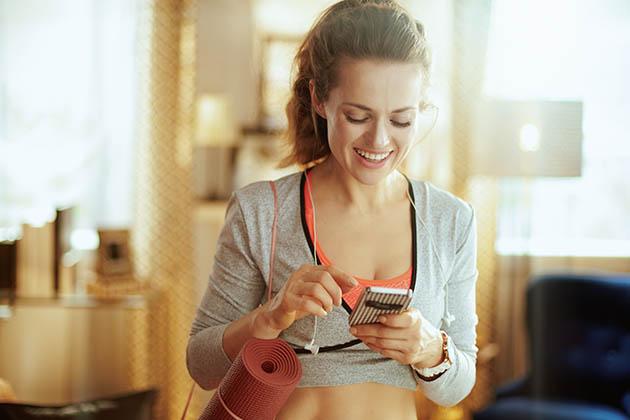 widgets, sporty woman using smartphone