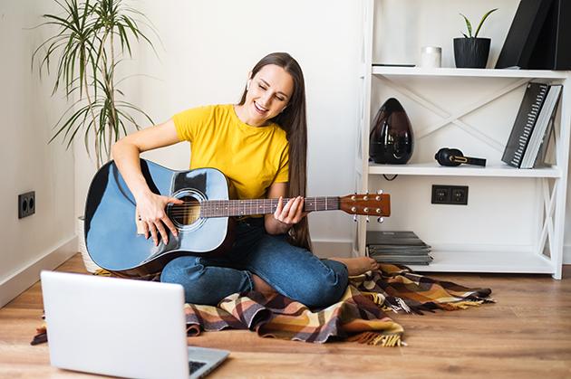 music school, woman teaches music lesson