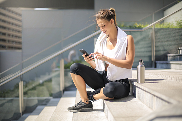 automated marketing, sporty girl taking a break with her phone