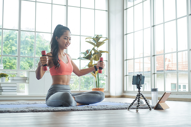 Zoom integration, woman exercise with dumbbell