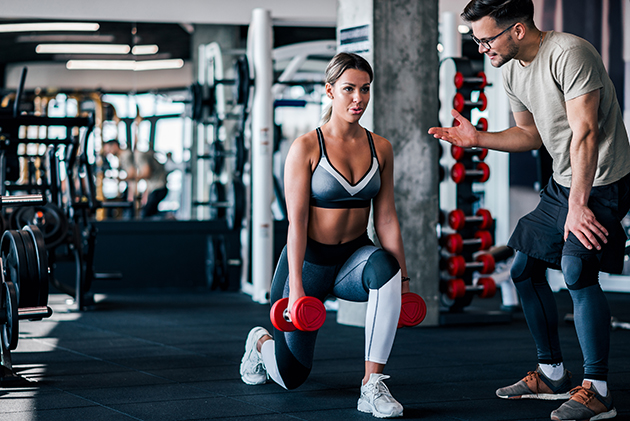 NPE, young muscular woman doing weighted lunge with dumbbells