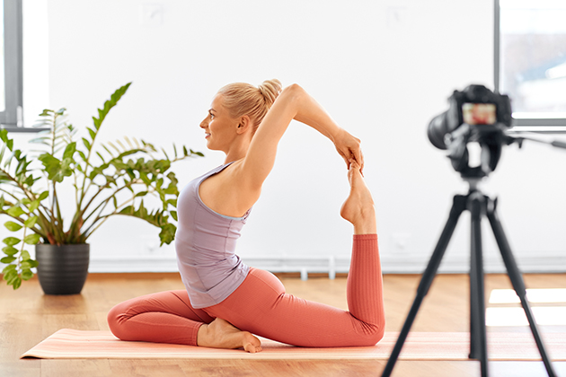 fitness business, woman with camera streaming for yoga blog at home