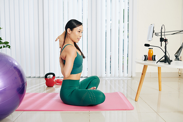 virtual content, woman conducting online yoga class