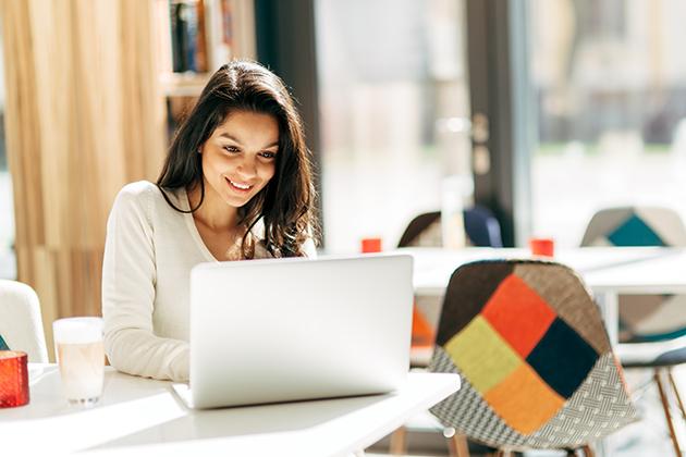 wellness center, brunette using laptop