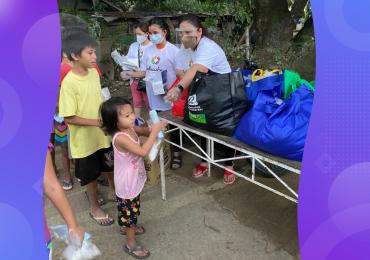 typhoon relief, WellnessLiving team distributing supplies