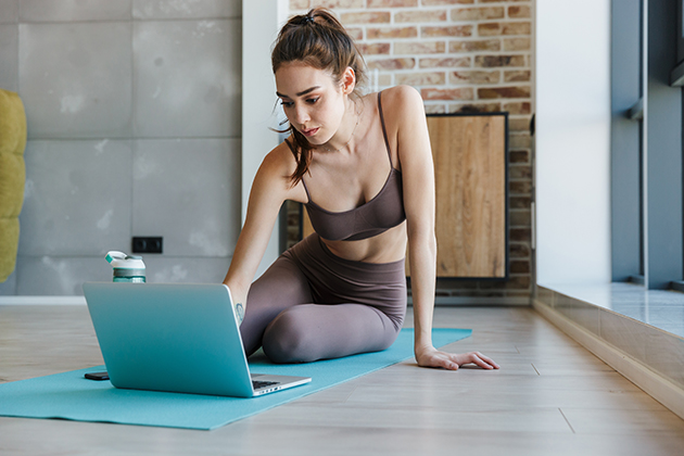 increase profits, young athletic woman using laptop while working out