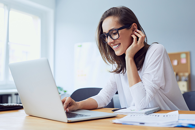 business advisor, beautiful cheerful young businesswoman working on laptop and laughing in home office