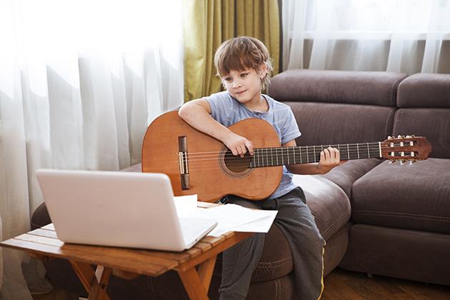 music school, boy taking an online music class
