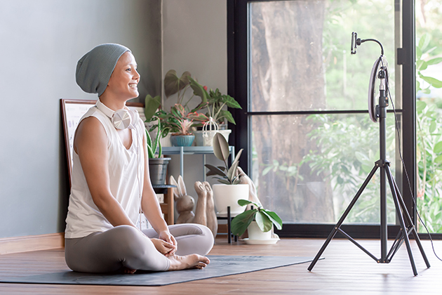 yoga workshops, Asian woman doing meditation and streaming online video