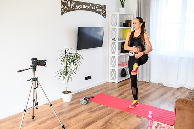 licensing or franchising, young woman records sports videos