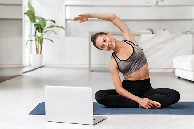 fitness culture, female yoga instructor conducts online class from home