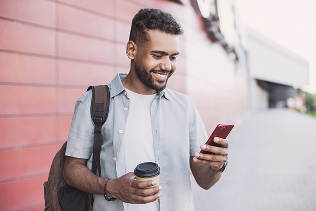 take your business virtual, young handsome man using smartphone