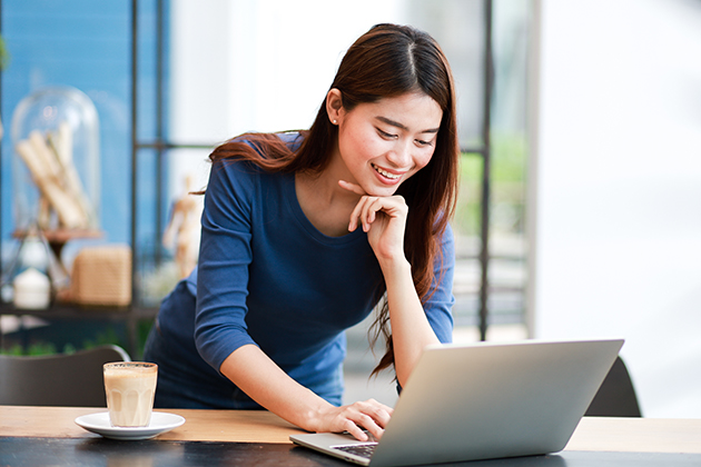 manage your dance studio staff, Asian woman at her computer