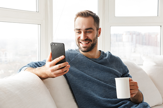 New Year's resolution, attractive young man relaxing with phone