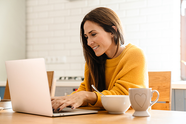 fitness email newsletter, woman at her computer