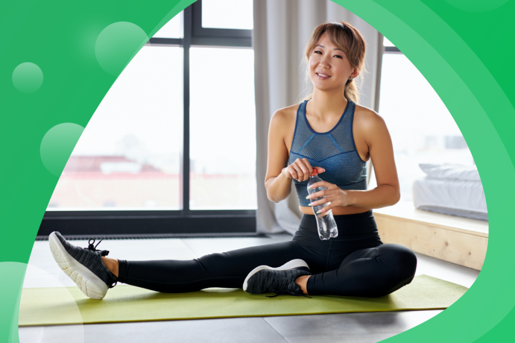 eco-friendly fitness studio, woman with a water bottle
