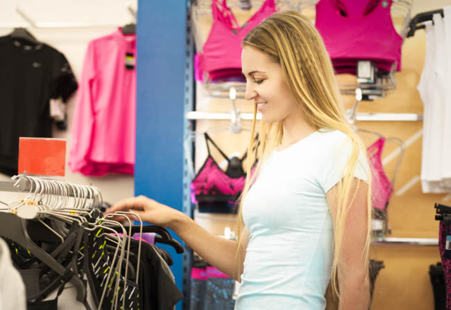 Yoga Studio Merchandising, young woman shops for yoga clothing