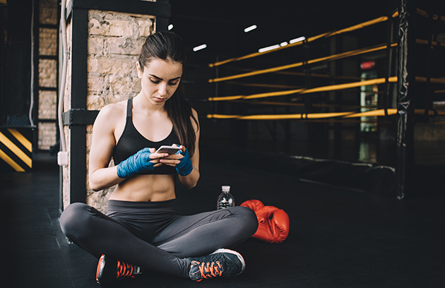 martial arts studio, boxer on phone