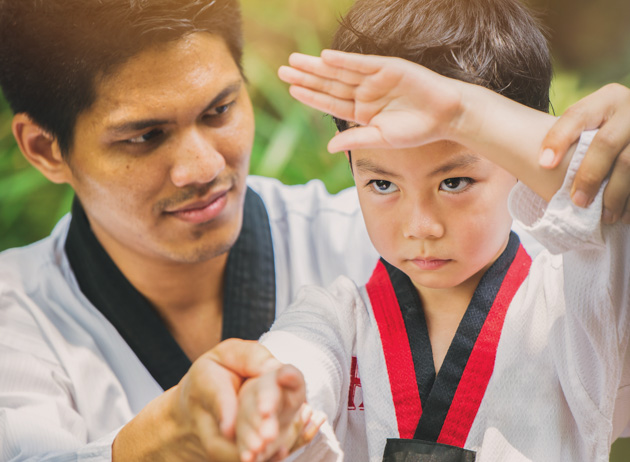 teaching children martial arts, Taekwondo master with student