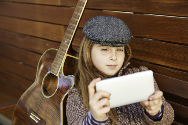 loyalty rewards program, little girl taking a selfie with guitar