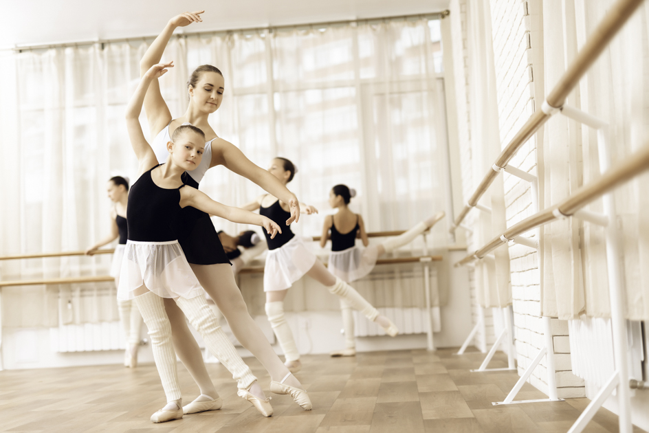 student retention tips, ballet instructor with little girl