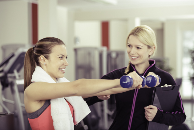 gym staff, trainer with female client