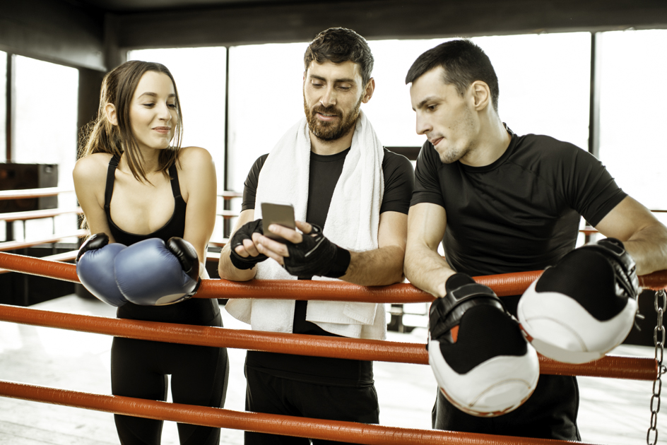 martial arts social media marketing, three boxers on phone