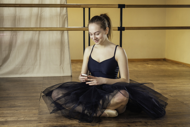 dance school software, ballerina on phone
