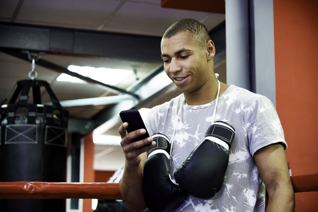 martial arts software, boxer on phone