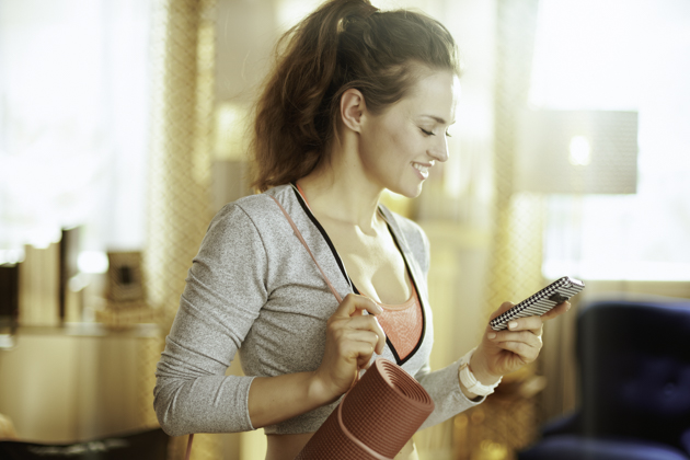 Pilates studio software, woman on phone