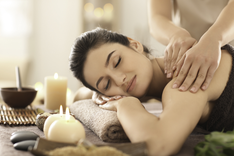 client retention plan, Young woman receiving massage in spa salon
