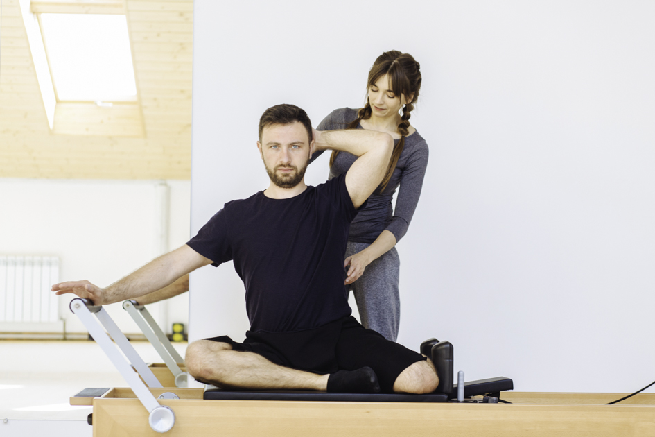 Pilates studio business plan, Pilates instructor with client