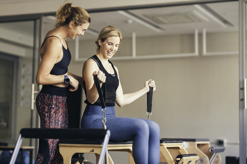 Pilates trends, Smiling women doing pilates workout at the gym